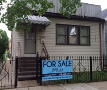 LENDER OWNED Single-family Residential Home with In-Law Units in Portage Park