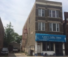 BANK OWNED 8 Unit Brick Building plus additional vacant side lot with Garage in Little Village